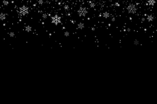 Snowflakes falling for christmas decoration abstract black background.