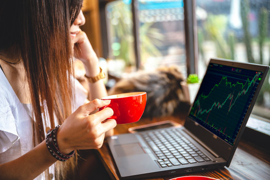 Intraday stock trader businesswoman working at coffee shop bar for business cafe hopper lifestyle.