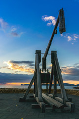 Alghero,  sunset view of the Alghero old town quarter with historic defense walls, fortifications and catapult construction, Sardinia -Italy
