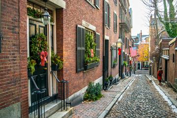 "Acorn Street at Christmas Time: Classic ""All-American"" New England Cobblestone Street, Brick Buildings, and American Flag in Historic Beacon Hill Neighborhood (Winter) - Boston, Massachusetts, USA"