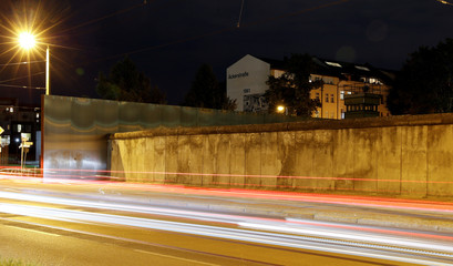 A long exposure picture shows a general view of remains of the Wall at the Berlin Wall memorial on Bernauer Strasse at night in Berlin
