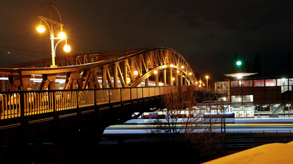 A long exposure picture shows the Boese Brucke bridge at former Bornholmer Strasse Berlin Wall border crossing point at night in Berlin