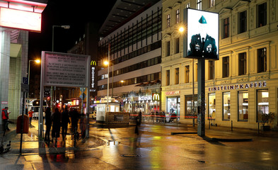 A long exposure picture shows the former Berlin Wall border crossing point Checkpoint Charlie at night in Berlin