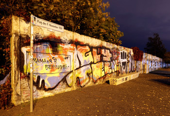 A long exposure picture shows remains of the Wall at former Bornholmer Strasse Berlin Wall border crossing point at night in Berlin