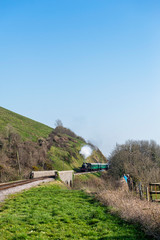 Steam Train Moving Slowly Through the Countryside