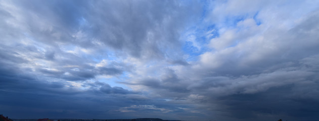 Heavy rain clouds. Photography, atmospheric phenomena, panoramic image of the autumn sky.