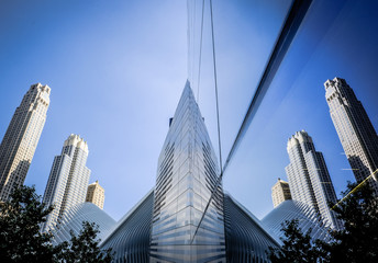 Abstract, reflective view of buildings seen reflecting off glass panels in Manhattan, New York. Wall mural