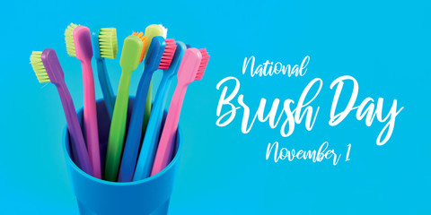 National Brush Day images. Colored toothbrushes stock images. Morning hygiene. Bathroom accessories images. Toothbrush on a blue background. Brush Day Poster, November 1. Important day Wall mural
