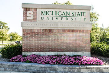East Lansing, Michigan, USA - September 17, 2018: Sign for the Michigan State University campus. MSU is home to the Michigan State Spartans and a world renowned research facility.