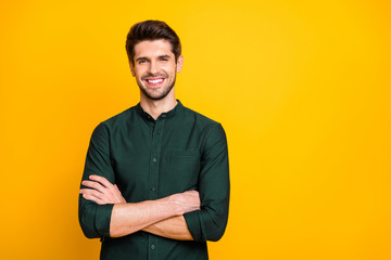 Fototapeta Portrait of confident cool entrepreneur guy cross hands look feel positive cheerful emotions real professional expert wear casual style clothing isolated over yellow color background obraz