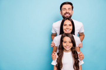 Portrait of positive cheerful stack of mommy daddy kid with wavy curly hairstyle enjoy relax rest feel dream wear white stylish t-shirt casual style isolated over blue color background Wall mural