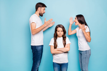 Family everyday insults. Profile side photo of outraged mom dad with brunet hair argue have disagreement and offspring annoyed wear white t-shirt denim jeans isolated over blue color background