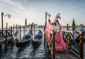 Wall Murals Gondolas Colorful carnival masks at a traditional festival in Venice, Italy
