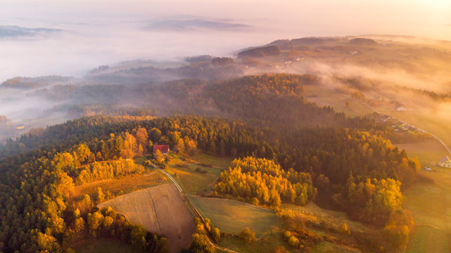 Colorful Sunrise over Forest and Countryside in Poland. Aerial Drone View