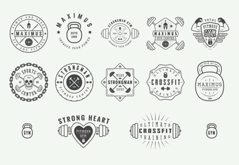 Set of gym logos, labels and slogans in vintage style. Graphic illustration