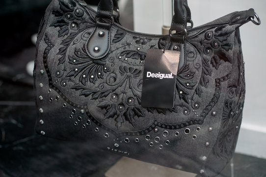 Mulhouse - France - 1 November 2019 - Closeup of black desigual handbag in luxury fashion store showroom