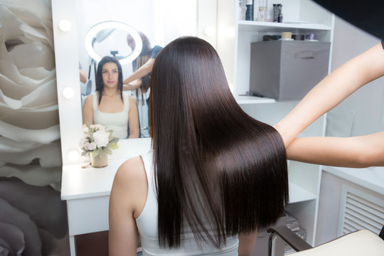 Saturated healthy shiny hair after keratin recovery. The concept of recovery structure.