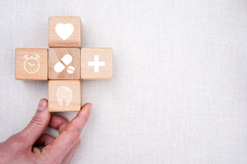 Doctor hand arranging wood block stacking with icon healthcare and medical, background for your health.