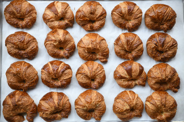 Close up of croissants on baking tray
