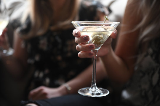 Close up of woman holding cocktail drink