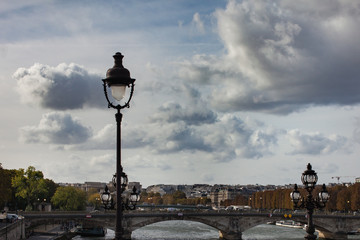 Street lamp on a background of beautiful cloudy blue sky and Paris river cancel