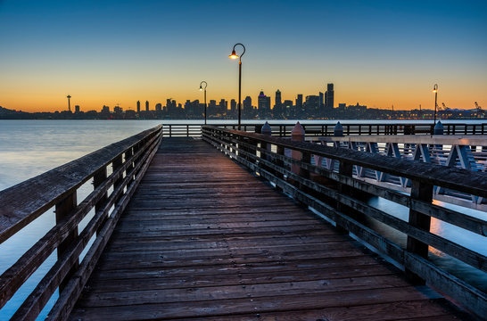 Wooden pier and skyline at dawn, Alki Beach, Seattle, Washington State