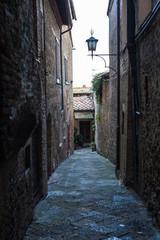 Aluminium Prints Narrow alley Narrow dark alley in old town Italy