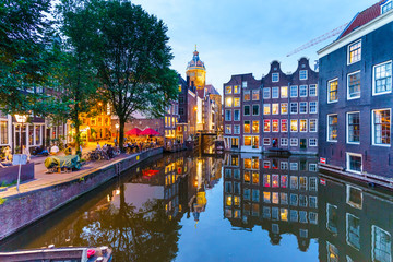 Old gabled buildings by a canal at dusk, Oudezijds Kolk, Amsterdam, Netherlands