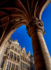 Tuinposter Historisch mon. Low angle view of Grand Place against blue sky
