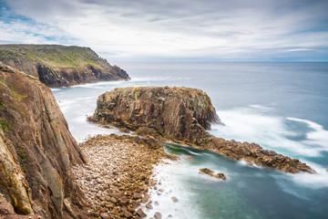 Enys Dodnan rock formation at Lands End, Cornwall, England, United Kingdom, Europe.