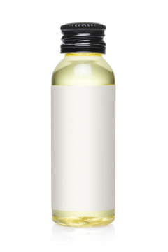 Small bottle containing yellow liquid, isolated on white background