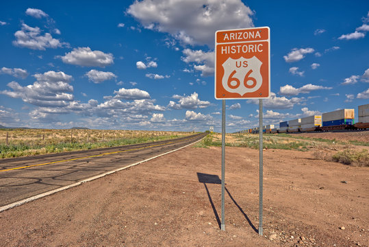 Road sign marking Historic Route 66 just east of Seligman AZ, which is the birth place of the famous road.