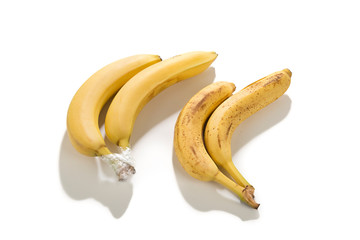 Practical solution; plastic wrap will help slow bananas down from ripening.