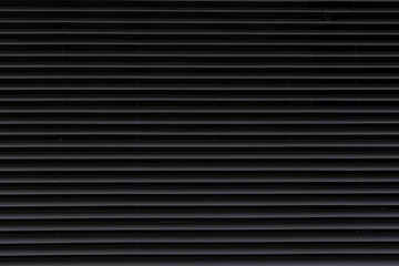 Dark corrugated metal surface for wall background.