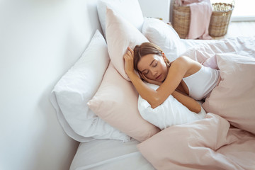 Young female person sleeping at day time