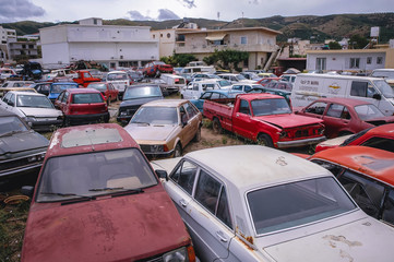 Kissamos, Greece - May 18, 2007: Car cemetery in Kissamos town on a Greek Island of Crete