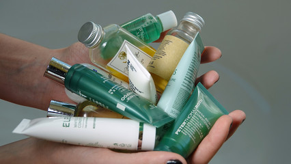 Hands holding travel size toiletries. California signed bill to ban hotels from supplying such bottles by 2023 in effort to reduce plastic waste. Photo taken Vista, CA / USA - October 30, 2019.