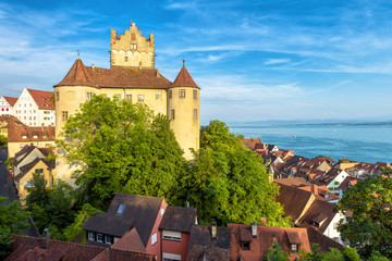 Fototapete - Medieval Meersburg Castle at Lake Constance or Bodensee, Germany. It is a landmark of Meersburg town. Landscape with old German castle in summer. Scenery of tourist attraction in sunset light.