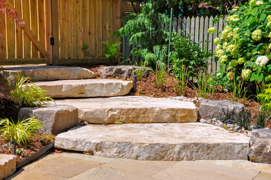 Huge natural stone slab steps create a beautiful urban front garden, and a safe transition to a hidden upper garden.