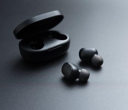 Black wireless earphones in-ear with charging case