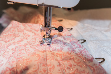 sewing machine on pink patterned fabric