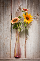 bouquet of flowers on wooden background