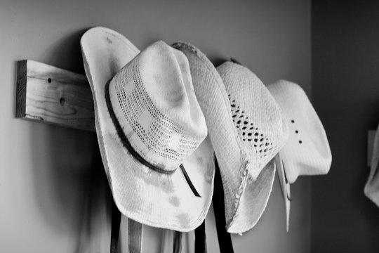 cowboy hats hung up on wall