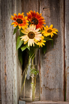bouquet of yellow flowers on wooden background