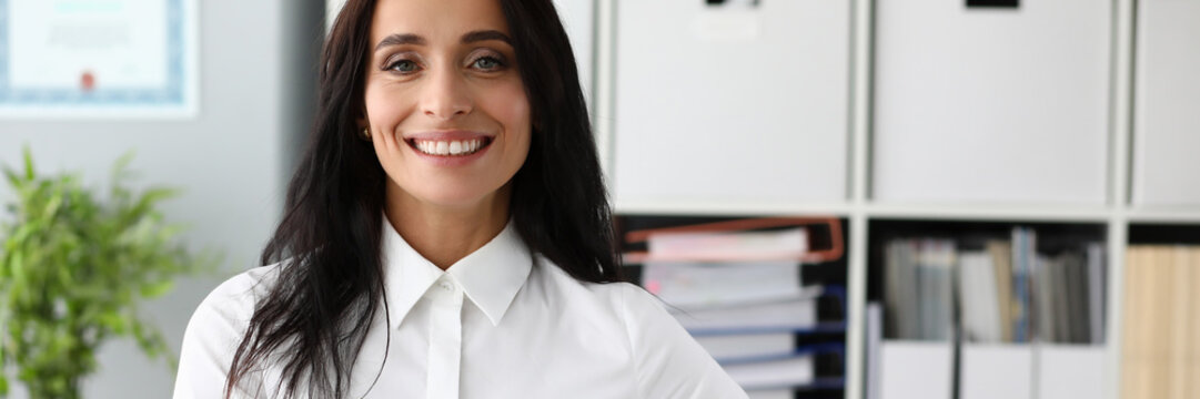 Business woman in white shirt against office