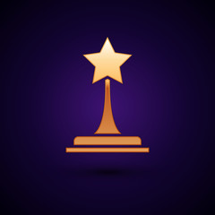 Gold Movie trophy icon isolated on dark blue background. Academy award icon. Films and cinema symbol. Vector Illustration