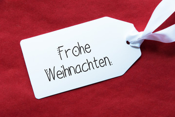 Label With German Calligraphy Frohe Weihnachten Means Merry Christmas. Red Textured Background