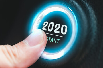 Finger pressing a 2020 start button. Concept of new year.