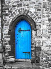 A blue church door Penzance Cornwall with saturated blue and grey stonework