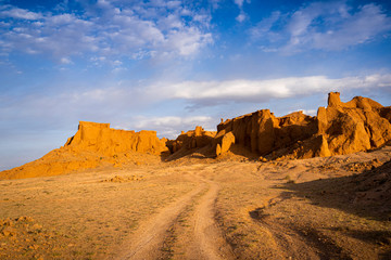 The orange rocks of Bayan Zag, commonly known as the Flaming Cliffs in the Gobi desert, Mongolia where important dinosaur fossils were found, Mongolia, Mongolian, Asia, Asian.